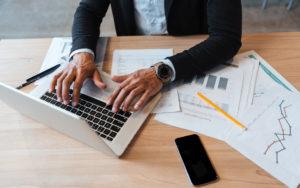 header-man-typing-on-laptop
